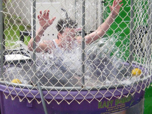 Volunteer Joey Appleby splashes into the dunk tank Saturday, May 28, 2011, during the Dog and Pony Tavern of Bar Harbor's second annual fundraiser for the Hancock County branch of the Society for the Prevention of Cruelty to Animals. The benefit raised $3,420.