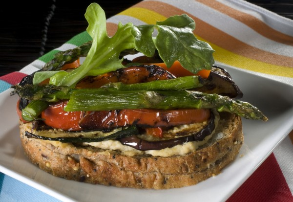 Grilled vegetable tartine with low-fat hummus served as an open-face sandwich.