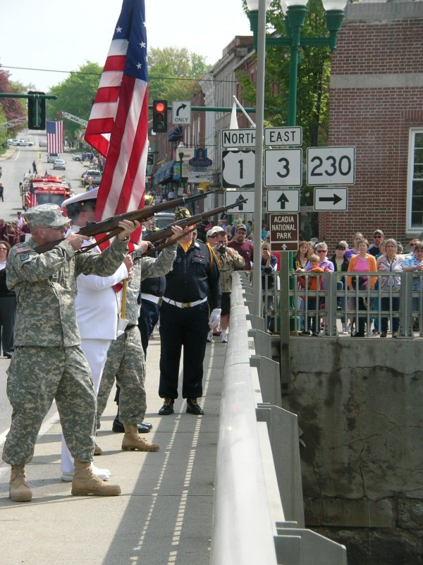 As taps played in the background, an honor guard fired a salute Monday as part of a ceremony on the Union River Bridge in Ellsworth honoring those veterans who died at sea. The ceremony took place during the Memorial Day Parade in Ellsworth.