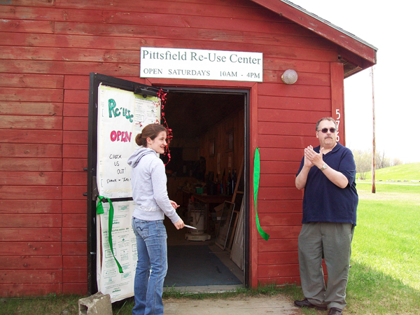 Pittsfield Mayor Timothy Nichols and volunteer Shantel Lausier cut the ribbon at the grand opening of the town's new reuse center. The center opened Saturday morning and is now accepting donated items.
