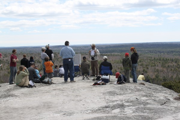 "David Lovitch, owner of Freeport Wild Bird Supply, leads a introduction to hawk watching workshop on the summit of Bradbury Mountain on Saturday, April 30, during the first ""Feathers Over Freeport"" weekend-long bird-watching festival."