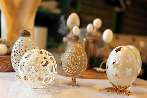 Eggs from various types of birds -- the smallest being finch eggs -- are on display on the work table of Georgette Kanach's studio in Gray. She has been practicing egg carving for 15 years and she sells them as ornaments, on pedestals and as cake toppers.