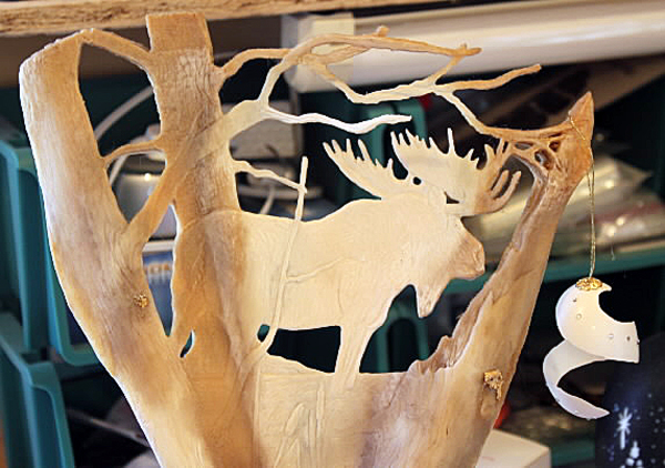 A egg ornament dangles from a moose shoulder bone, both carved by Master Maine Guide Georgette Kanach of Gray. She works with natural materials in making the majority of her artwork, which she enters into Maine sportsman's shows.
