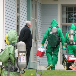 A hazmat team made up of members of the Orono-Old Town Regional Rapid Response Team and from the Maine National Guard Civil Support Team in Waterville enter the Bar Harbor Bank and Trust operations center in Ellsworth on Thursday to retrieve samples of a white powder discovered in an envelope. Emergency personnel evacuated the building and workers waited throughout the afternoon before they learned that the substance did not contain any hazardous materials