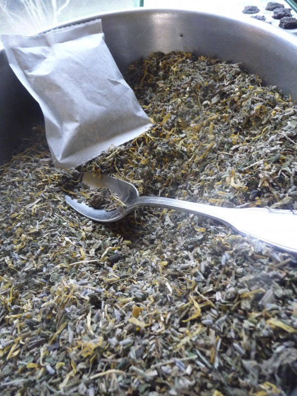 An all-organic fertilization tea for plants and gardens is bagged at Heidi Herzbergen's Trescott Township home and business, Heidi's Plant Prep.