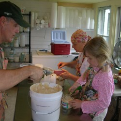 The whole family gets into the act at The Ice Cream Lady in Brooklin. While her husband Chris Hurley and daughter, Isabelle Hurley, pack a fresh batch of Espresso Toffee Chip ice cream into pint cartons, Nancy Veilleux tops each one off with some fresh toffee chips before snapping on the lid and loading the pints into the outdoor freezer.