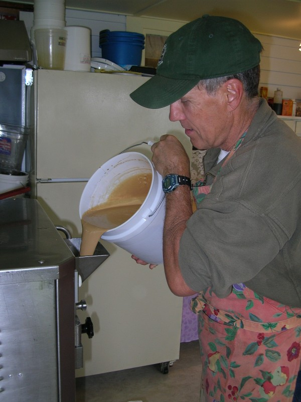 Chris Hurley pours the milk mixture into the 25-year-old Italian ice cream maker that he, his wife Nancy Veilleux and daughter Isabelle Hurley use to make the homemade ice cream their business The Ice Cream Lady, produces and sells to a growing number of commercial customers on the Blue Hill Peninsula and beyond.