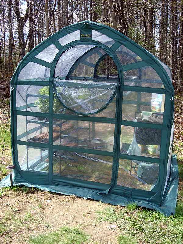 The popup greenhouse has a zippered door and window, both with screens to keep the bugs out.