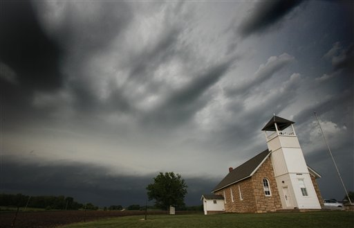 Storms clouds pass behind Buck Creek School near Lawrence, Kan., Saturday, May 21.