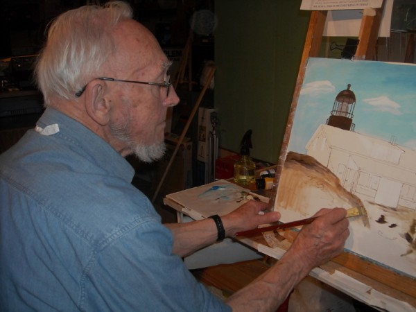 Former lighthouse keeper Ernie DeRaps busy at work painting Maine's Seguin Island Lighthouse.