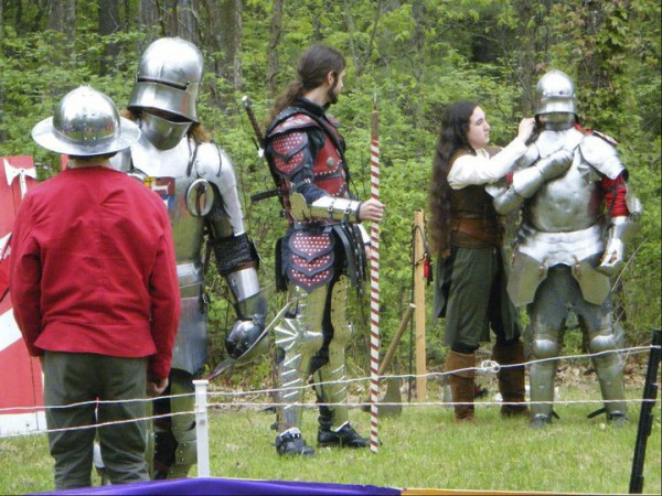 Sir Brian (left) and Sir John (right) prepare to fight at this year's New Hampshire Renaissance Fair in Kingston, N.H. They are being attended by Squires Edward and Tannis, and marshaled by Sir Jordan. The group recently visited Rockland Middle School.