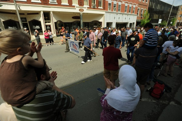 Veterans march up Main Street in Bangor as parade goers watch and applaud on Saturday, May 30, 2011.