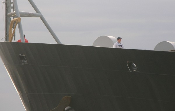A Maine Maritime Academy student watches from the bow of the college's training vessel State of Maine Tuesday as the ship embarks on its annual 60-day training cruise.