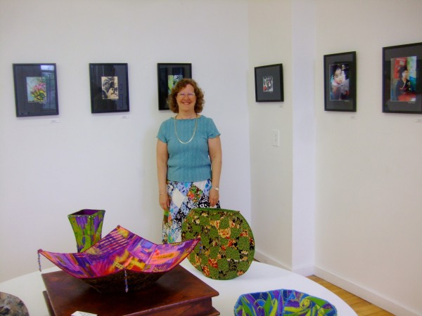 "Betsy Headley of Belfast, organizer and artist of ""A Moment in Time,"" an exhibit that will run through May 30 at the Lincoln Street Center for Arts and Education at 24 Lincoln St. in Rockland, stands in front of a selection of her photographs taken while she taught English in Japan from 2007 to 2009."