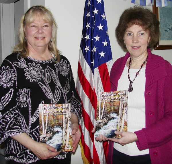 Paulette Oboyski (left) and Cheryl McKeary hold copies of Washington, Maine: People and Places. The book is available for purchase now at Gibbs Library to celebrate the town's bicentennial celebration. Proceeds benefit the Washington Historical Society and the Gibbs Library.