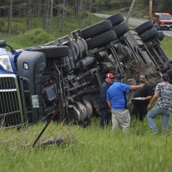 Truck overturns in Whiting, spills load of herring