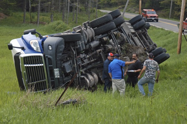 A Maritime Farms oil tanker rolled over Friday at about 5:45 p.m. on the northbound side of Route 1 in Warren in a field just north of Evergreen Ridge Alpacas farm.