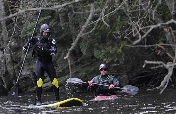Rafael Grossmann (left) of Holden and EMHS co-worker Adam Swett of Old Town paddle against the Stillwater River's current in an area known as the &quotElbow&quot just below the Stillwater Dam in Old Town on Wednesday afternoon.