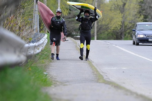 Adam Swett (left) of Old Town and friend Rafael Grossman of Holden lug their water craft back to their cars on College Avenue after they paddled the Stillwater River in an area known as the &quotElbow&quot just below the Stillwater Dam in Old Town on Wednesday afternoon. &quotThe water is nice and high and a little washed out, &quot said Swett. &quotThe icebergs are gone.&quot