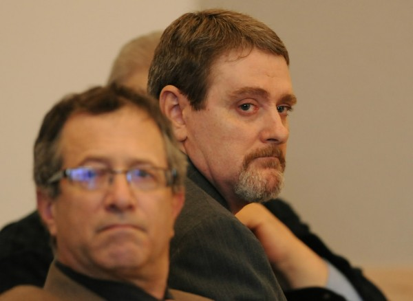 Perley Goodrich Jr. (right) looks toward his mother and sister on Wednesday, May 11, 2011, as they approach the podium to address the court at the Penobscot Judicial Center in Bangor during Goodrich's sentencing in the shooting death of his father in October 2009. With Goodrich is his attorney Jeffrey Silverstein of Bangor.