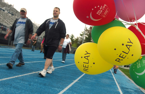 Walkers brave the damp rainy weather on Saturday as they participate in the 2011 Penobscot Relay for Life held at Morse Field on the campus of the University of Maine in Orono. The event, which raises money and awareness for the American Cancer Society, kicked off on Friday evening and concluded at noon on Saturday.