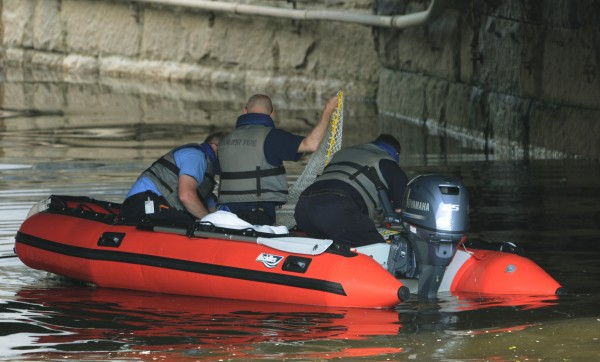 Bangor Fire personnel investigate the report of a body floating in the Kenduskeag Stream in downtown Bangor on Monday, May 30, 2011.