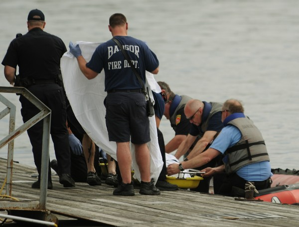 Bangor Fire and Rescue personnel along with Bangor Police investigate the report of a body floating in the Kenduskeag Stream at a dock along the Penobscot River.