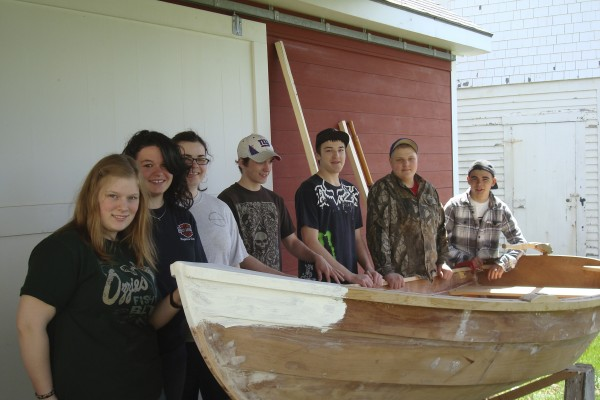 Searsport District High School students (from left) Rebecca Trimble, Holly Hassapelis, Emily LaRosa, Shane Sauer, Jason Pendleton, Derrik Kenney and Alex Lane will launch two boats they built for a science class at noon, Friday at the Searsport town dock.