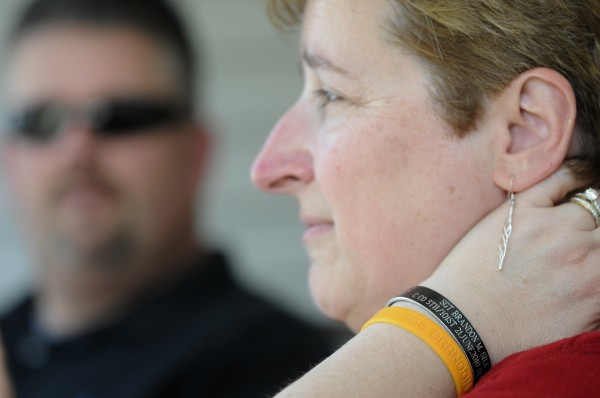 It has been nearly a year since Lynn Silk (right) and husband Mark Silk (in background) lost their son Staff Sgt. Brandon Silk in a helicopter crash during his deployment in Afghanistan. Lynn Silk and other family members wear memorial bracelets (seen on her left wrist) with their son's name to honor him. Photographed Friday, May 27, 2011 at Lynn and Mark Silk's home in Orono.