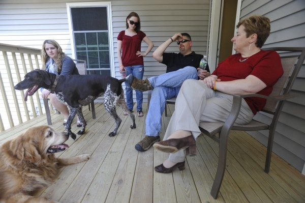 Members of the Silk family share cherished memories of Staff Sgt. Brandon Silk while takling with the BDN on the family's back porch in Orono Friday, May 27, 2011.  From left are Brandon's cousin Katelynn Ronan, Brandon's sister-in-law, Jaclyn Silk, and Brandon's parents--Mark and Lynn Silk. It has been nearly a year since the Silks lost Staff Sgt. Brandon Silk in a helicopter crash during his second deployment to Afghanistan.