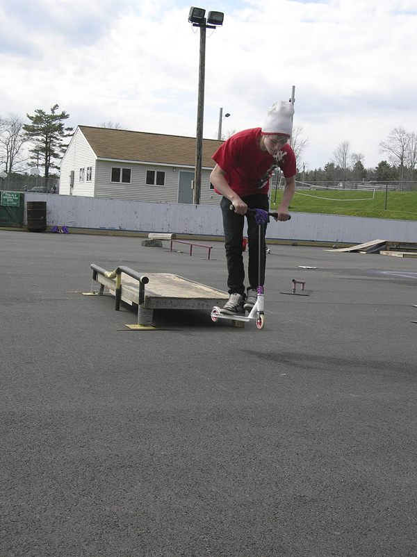 Christopher Cherry, 14, of Bucksport catches some air recently off one of the homemade fixtures youngsters have set up at the town's ice skating rink. A group of teens, backed by the town, hope to garner support from local residents to build new and expanded features for bikers, skateboarders and scooter riders.