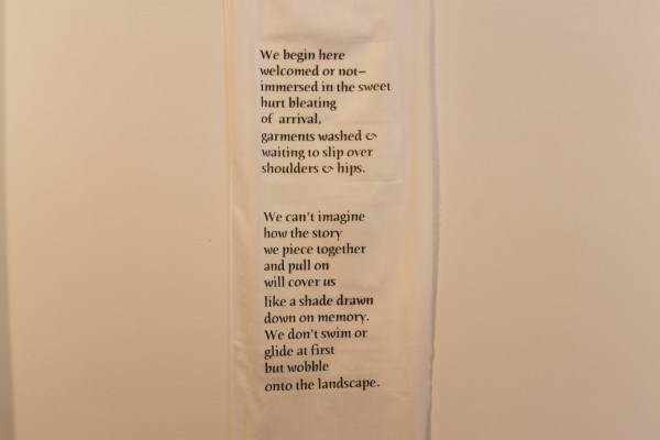 "A poem by Barbaria Maria of Belfast is displayed on a roll of muslin in the Clifford Gallery of Waterfall Arts in Belfast as part of ""Soul Migration"" a solo exhibition of images, sounds and poems by Barbaria Maria."
