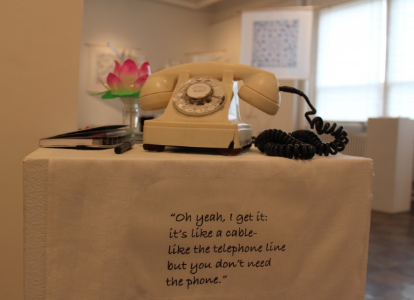 "The telephone is a part of ""Soul Migration"" an installation of images, sounds and poems by Barbaria Maria of Belfast on display at Waterfall Arts in Belfast through May 27. Beside the telephone is a black book where visitors have been writing messages to their lost family members."