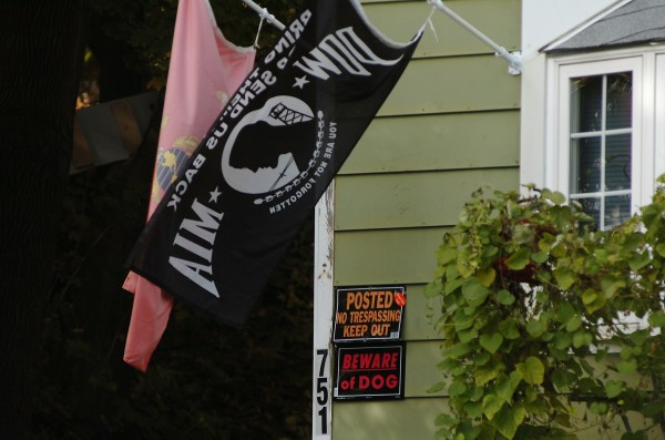 A U.S. Marine Corps flag, a P.O.W-M.I.A. flag, a no trespass sign and dog warning were seen at this 751 Main Street home in Bangor late Sunday morning, Oct. 24, 2010. Police closed down part of Main Street as well as part of  the neighborhood near the home during a standoff with a man inside the home Saturday evening, Oct. 23, 2010. Just after midnight Sunday, the Special Response Team fired tear gas into the house and arrested the man. He was transported to Eastern Maine Medical Center for evaluation.
