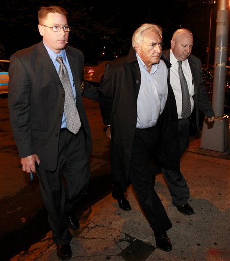 International Monetary Fund leader Dominique Strauss-Kahn, center, is brought into the Municipal Court, Monday, May 16, 2011 in New York.