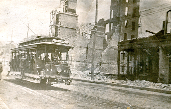 The State Street loop trolley was the first to get going through Bangor after the fire. This Exchange Street scene from the collection of Dick Shaw shows the remains of the Morse-Oliver building in the background at the intersection of State and Exchange streets, and Speed's Restaurant on the right.