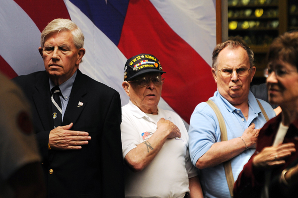 Nelson Durgin (from Left),  along with Maine Troop Greeter Norman Rossignol, George Newhall and U.S. Sen. Susan Collins, listen as the National Anthem is sung during the 8th anniversary celebration of the Maine Troop Greeters at Bangor International Airport on Saturday, May 21, 2011.