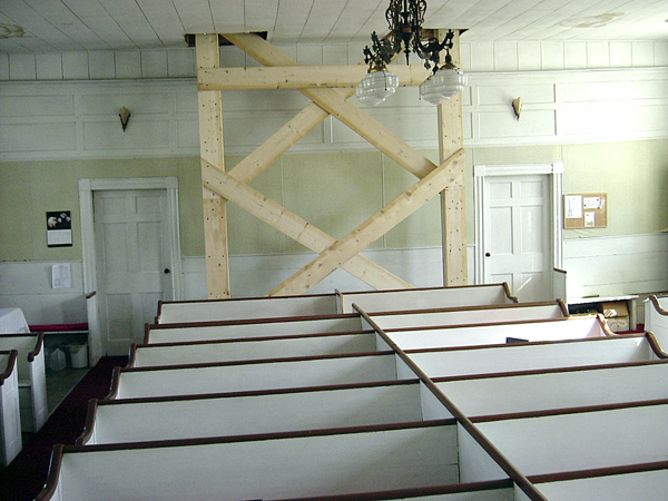 A massive brace to support the weight of the Troy Union Church belfrey has been installed until further restoration work can begin.