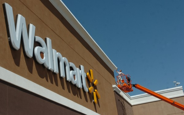 A laborer works on completing the finishing touches to the new Bangor Walmart in July 2009.
