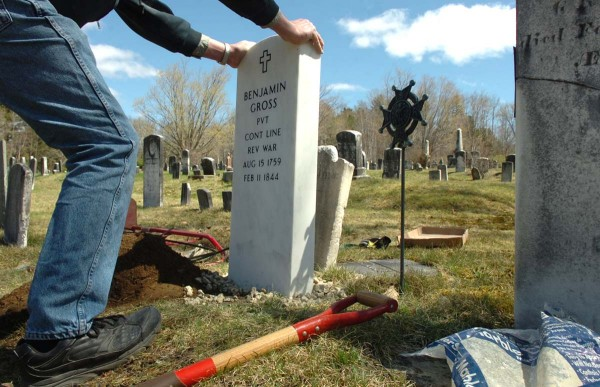 Larry Wahl of Orland straightens a new headstone which he helped install on the grave of Revolutionary War veteran Benjamin Gross on Sunday, May 1, 2011, at the Riverview Cemetery in Bucksport. The new headstone, which replaces the original one that had cracked in two due to age, will be formally dedicated on May 14.