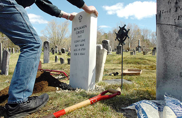 Larry Wahl of Orland straightens a new headstone which he helped install on the grave of Revolutionary War veteran Benjamin Gross on Sunday, May 1 at the Riverview Cemetery in Bucksport. The new headstone, which replaces the original one that had cracked in two due to age, will be formally dedicated on May 14.