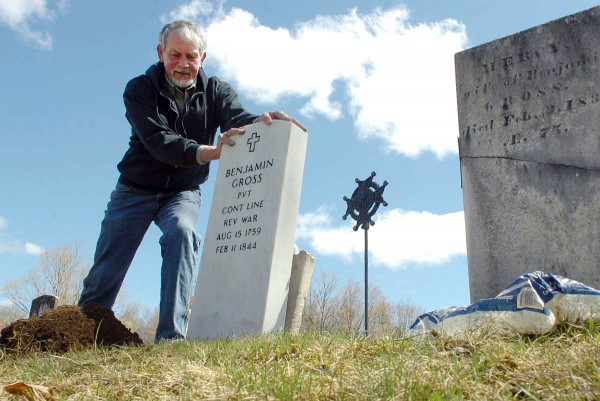 Larry Wahl of Orland straightens a new headstone which he helped install on the grave of Revolutionary War veteran Benjamin Gross on Sunday, May 1 at the Riverview Cemetery in Bucksport. The new headstone, which replaces the original one that had cracked in two due to age, will be formally dedicated on May 14. All are welcome.