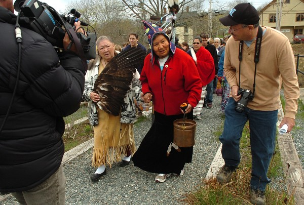 Joan Dana (left) of Indian Township, and Josephine Mandamin (center) of Ontario, carry a copper bucket filled with water from the Machias Bay as they prepare for a ceremony at Bad Little Falls in Machias on Saturday, May 7, 2011. Dana, of the Passamaquoddy tribe, and Mandamin, of the Ojibwe tribe, are among the dozens of participants in the 2011 Mother Earth Water Walk, which brings together Native Americans from across the continent to raise awareness concerning the importance of clean water. At far right is Donald Soctomah, also of Indian Township.