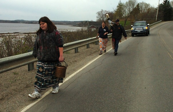 Cheyanne Lewe, 11, of Indian Township, carries a copper bucket filled with water from Machias Bay as she walks through Machiasport as part of 2011 Mother Earth Water Walk. The walk brings together tribes from the four corners of the continent to raise awareness of the importance of clean water and culminate with the tribes converging in Wisconsin in several weeks.