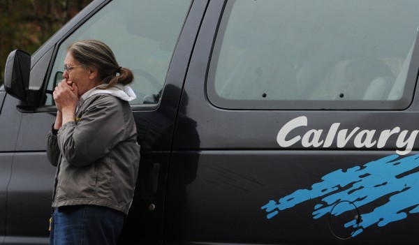 A church member stands her van and stares in disbelief as she watches the Calvary Apostolic Church in Winterport burn.
