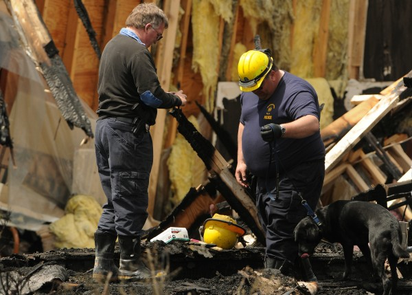 Officials with the Maine State Fire Marshals office investigate a fire at the Calvary Apostolic Church in Winterport on Friday, May 6, 2011. A body was recovered from the scene on Thursday and is being autopsied by the medical examiner.