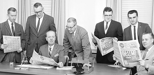 Executives of Freese's Department Store in Bangor are shown on May 29, 1961, checking the 32-page tabloid-format supplement that was to appear in that Wednesday's Bangor Daily News. Not only was it the largest ad ever published by Freese's, but it also was the largest single newspaper advertisement ever published in the state of Maine at the time. In 1960, Freese's had run a 28-page tab supplement. Pictured are (from left) Ronald E. Porter, advertising salesman, BDN; Frederick B. McAlary, BDN retail advertising manager; Irving E. Bezanson, general manager, Freese's Inc.; John D. Freese, merchandise manager; Richard J. Reilly, assistant general manager; A. James Bartlett, advertising manager; and William A. Freese, merchandise manager.