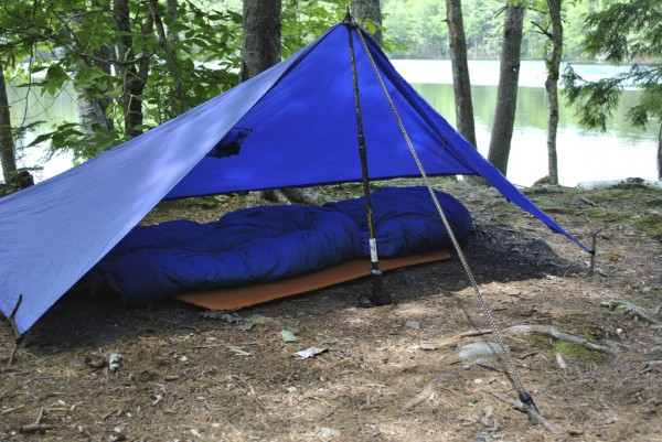 This single pole  setup is just one of a variety of ways to rig a tarp for sleeping.