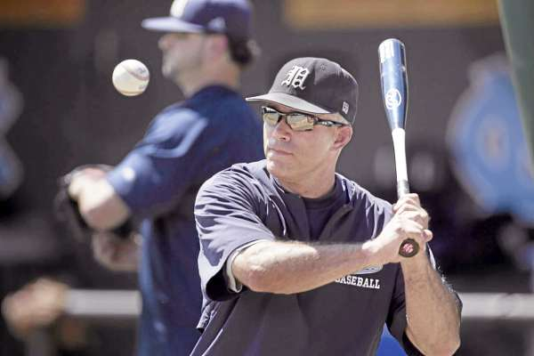 University of Maine baseball coach Steve Trimper hits during infield practice for the Black Bears Thursday at Boshamer Stadium in Chapel Hill, N.C., as they prepare for Friday's NCAA Regional contest against host North Carolina.