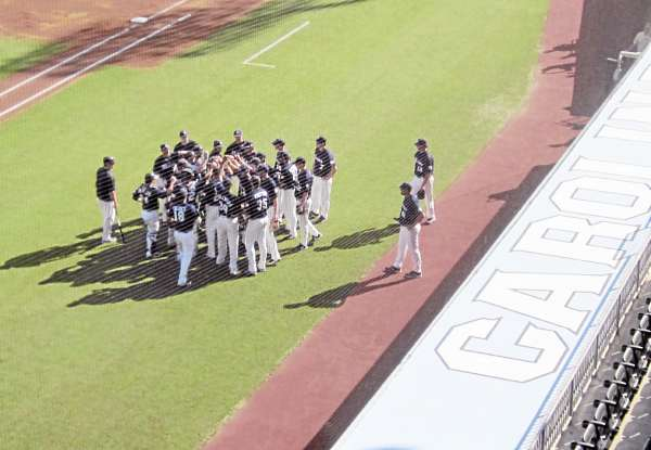 The University of Maine baseball team warms up for its NCAA Regional contest against North Carolina Friday. NC won 4-0.